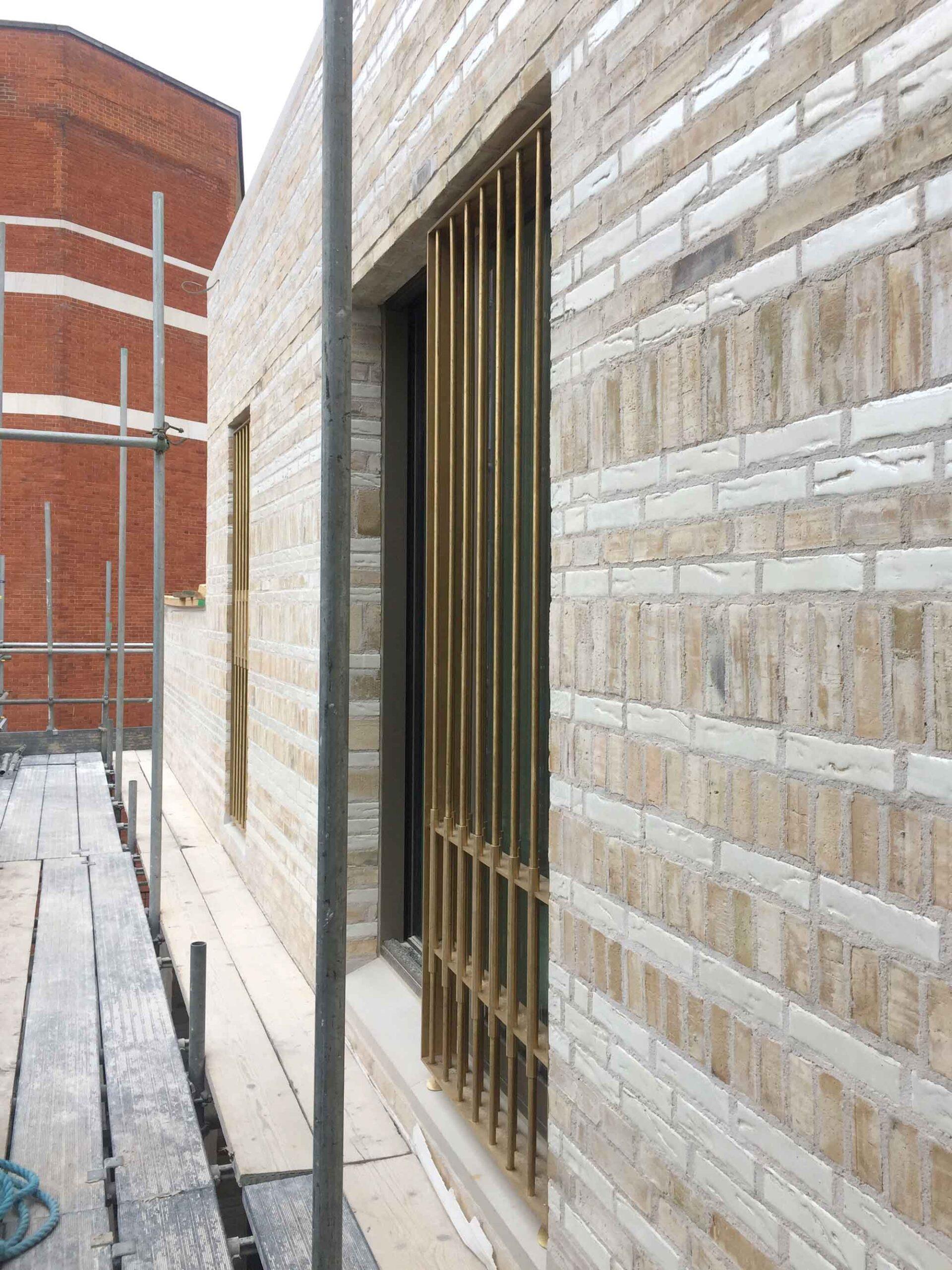 westminster-fire-station-openstudio-architects-metal-frame-window-screen