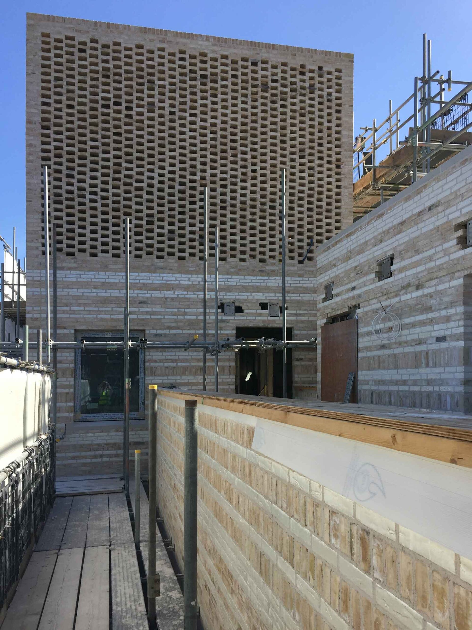 westminster-fire-station-openstudio-architects-perforated-brick-facade-plant